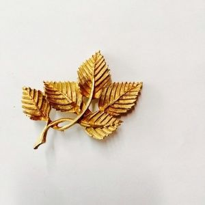 gold colored leaf brooch